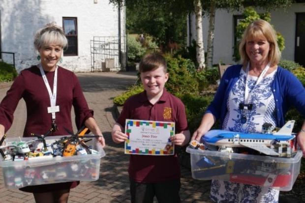 LEGO Charity Child Donates