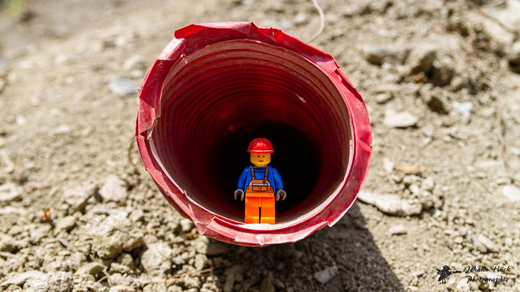 LEGO minifigure on construction site.
