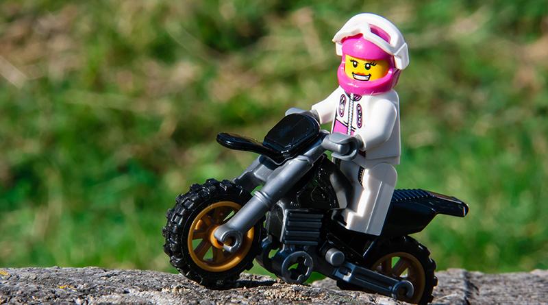 Brick Pic Woman Motorbike Featured