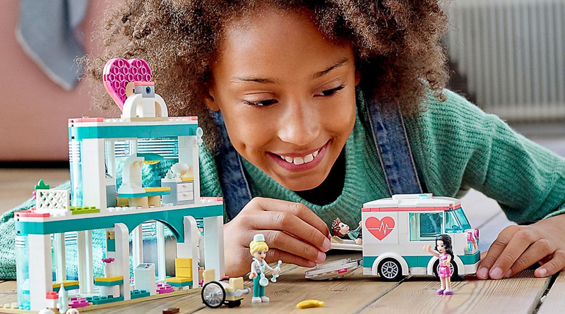 Girl building LEGO Friends set